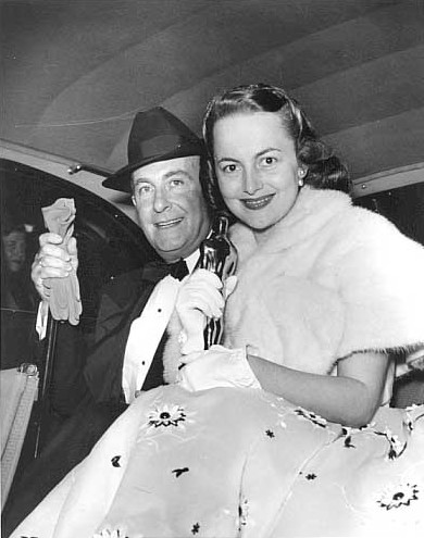 Olivia in 1947 posing with Oscar.